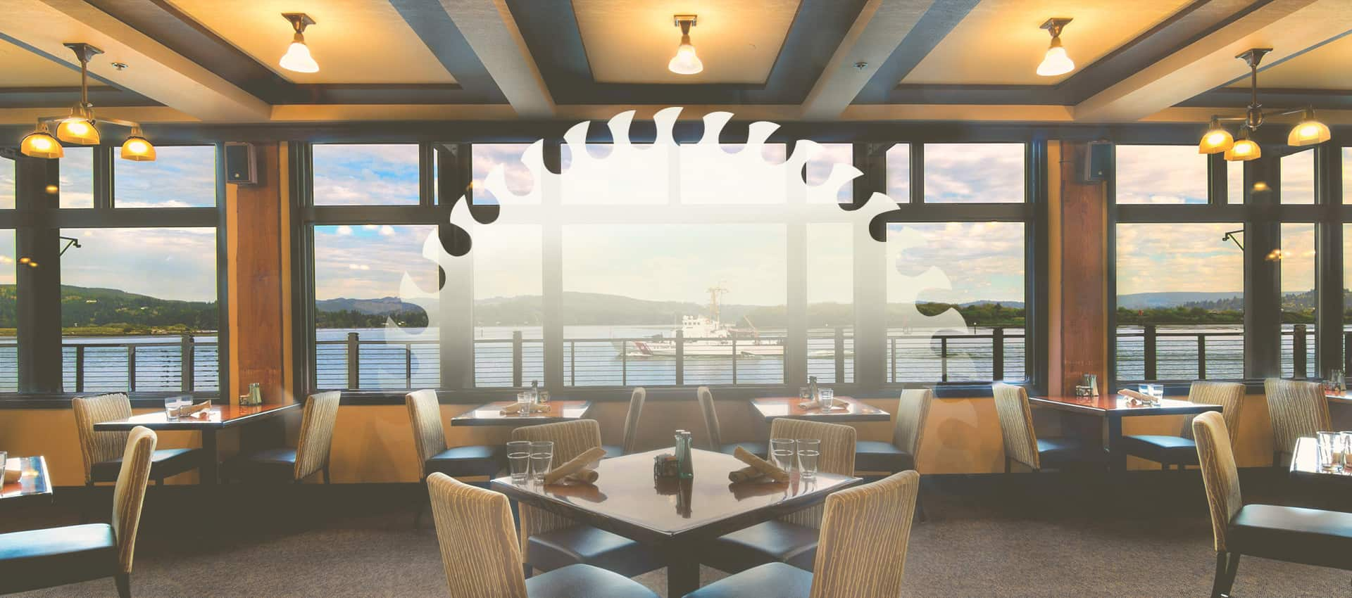 Restaurant dining area at The Mill Casino with view of bay