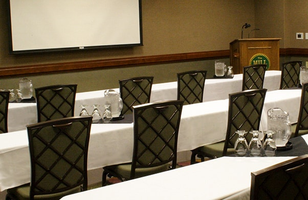 Meeting room with rows of seats and presentation space