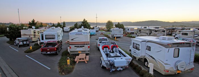 Overlooking Interior Pull-Through Sites with trucks, trailers, RVs and picnic table