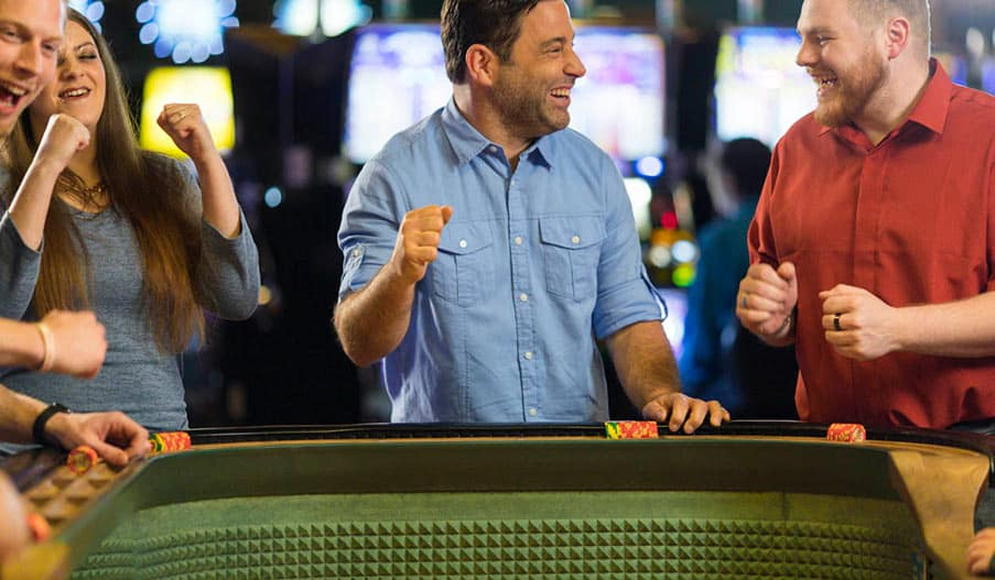 Man playing at a casino table.