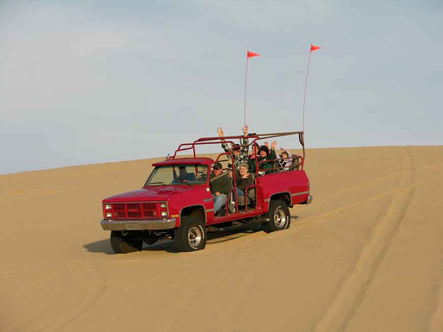 Riding on a tour truck on Oregon Dunes.